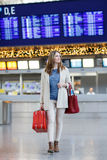 Young woman at international airport, goes to the gate Stock Photos