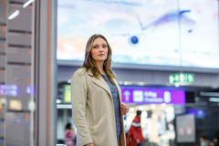 Young woman at international airport, goes to the gate Stock Images