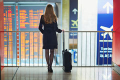 Young woman in international airport Royalty Free Stock Photos