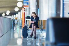 Young woman in international airport Stock Photos