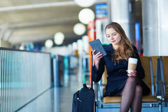 Young woman in international airport Stock Image