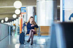 Young woman in international airport Stock Images