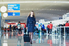 Young woman in international airport Royalty Free Stock Photography