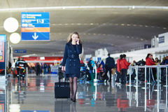 Young woman in international airport Royalty Free Stock Photo
