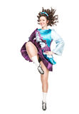 Young woman in irish dance dress dancing isolated stock photo