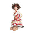 Young woman in irish dance dress jumping. Young woman in irish dance dress and wig jumping isolated Royalty Free Stock Photos