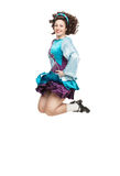 Young woman in irish dance dress jumping Royalty Free Stock Photos