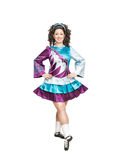 Young woman in irish dance dress posing isolated Stock Image