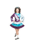 Young woman in irish dance dress posing isolated Stock Photos