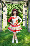Young woman in irish dance dress posing outdoor Royalty Free Stock Photo