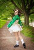 Young woman in irish dance dress posing outdoor Stock Photos