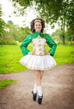 Young woman in irish dance dress posing outdoor Royalty Free Stock Photography