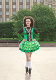 Young woman in irish dance dress posing Royalty Free Stock Image
