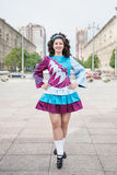 Young woman in irish dance dress posing Royalty Free Stock Photography