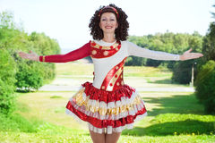 Young woman in irish dance dress welcoming outdoor Royalty Free Stock Photo