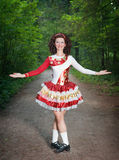 Young woman in irish dance dress and wig welcoming Royalty Free Stock Photo