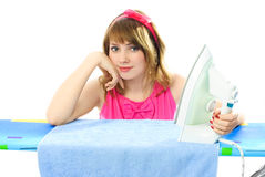 Young woman with an iron Royalty Free Stock Photography