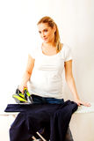 Young woman ironig man's jacket on ironing board Royalty Free Stock Photo