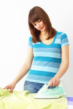 Young woman ironing Stock Image