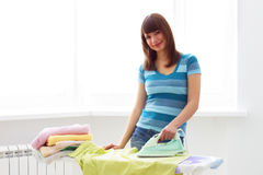 Young woman ironing Stock Photo