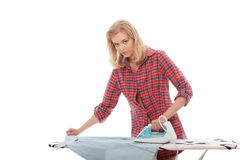 Young woman ironing Royalty Free Stock Photo