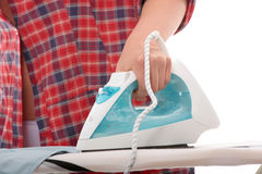 Young woman ironing Royalty Free Stock Photography