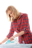 Young woman ironing Royalty Free Stock Photos