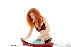 Young woman ironing Royalty Free Stock Image