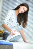 Young woman ironing. royalty free stock images