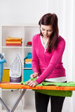 Young woman during ironing Stock Image