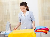 Young woman ironing clothes Royalty Free Stock Photo