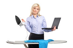 Young woman ironing his clothes Stock Images