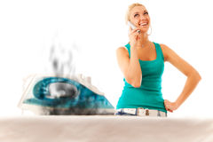 Young Woman Ironing Stock Photography