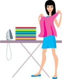 Young  woman irons clothes Stock Image