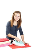 Young woman irons towels Stock Photography