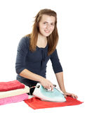 young woman irons towels Royalty Free Stock Photography