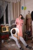 Young Woman Irritated to her Sleeping Partner Stock Photos