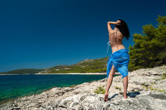 Young woman on island beach. Looking at sea view. Hvar, Croatia, Adriatic coast, popular touristic destination Stock Images