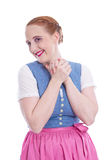 Young woman isolated in a dirndl - happy, laughing Stock Images