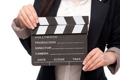 Young woman in a jacket and blouse. Movie clapper in women's hands, isolated on a white background Stock Images