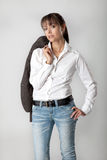 Young woman with jacket over her shoulder Royalty Free Stock Photo