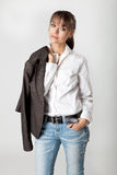Young woman with jacket over her shoulder Royalty Free Stock Image