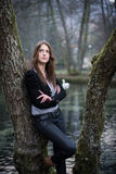 Young woman in jacket posing at the tree. Young woman posing at the tree Stock Images
