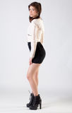 Young Woman in Jacket, Skirt, and boots Royalty Free Stock Photos