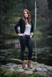 Young woman in jacket standing and posing. Young woman standing and posing Royalty Free Stock Photography