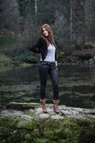 Young woman in jacket standing and posing. Young woman standing and posing Royalty Free Stock Image