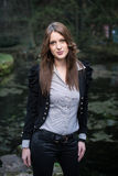 Young woman in jacket standing and posing at the lake Royalty Free Stock Photo
