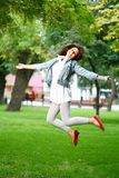 Young woman jamping on a grass Royalty Free Stock Photos