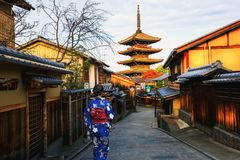 Young woman Japanese Kimono walking Yasaka in street near Pagoda royalty free stock image