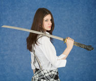 Young woman with the Japanese sword in a hand. Portrait of the young woman with the Japanese sword in a hand Stock Photos